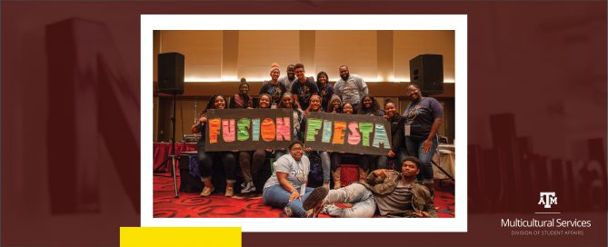 Fusion Fiesta staff with their event sign